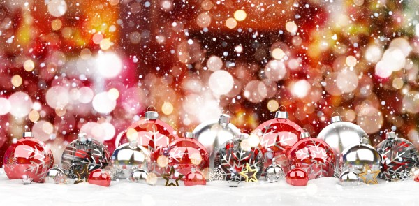 Red and white christmas baubles lined up on white background 3D rendering